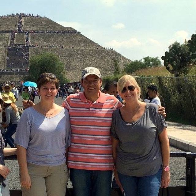 pyramids in mexico guide javier with happy clients